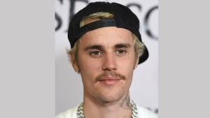 """In this Jan. 27, 2020 file photo, Justin Bieber arrives at the Los Angeles premiere of """"Justin Bieber: Seasons."""" The program is featured at The Paley Center for Media's PaleyFest LA. The festival is available on the Paley Center's YouTube channel. (Photo by Jordan Strauss/Invision/AP, File)"""