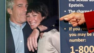 In this July 2, 2020, file photo, Audrey Strauss, acting U.S. attorney for the Southern District of New York, points to a photo of Jeffrey Epstein and Ghislaine Maxwell during a news conference in New York. On Tuesday, Nov. 24, one of Maxwell's attorneys said that her client is awakened every 15 minutes in jail while she sleeps to ensure she's breathing. (AP Photo/John Minchillo, File)