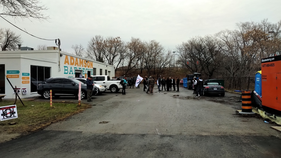 People are shown outside the Etobicoke location of Adamson Barbecue on Wednesday. The owner has vowed to reopen despite being ordered to close by Toronto Public Health. (Austin Delaney)