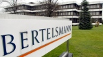 This March 13, 2003 file photo shows an exterior view of the German media giant Bertelsmann in Guetersloh, Germany. German media giant Bertelsmann said Wednesday that it is buying publisher Simon & Schuster from ViacomCBS for $2.17 billion in cash. (AP Photo/Michael Sohn, file)