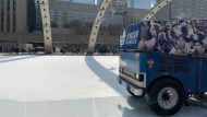 Skaters wait as a Zamboni cleans the ice at Nathan Phillips Square Feb. 16, 2020. (Joshua Freeman /CP24)
