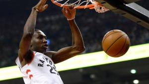 Toronto Raptors forward Chris Boucher (25) throws down a dunk against the Dallas Mavericks during first half NBA basketball action in Toronto, Sunday, Dec. 22, 2019. THE CANADIAN PRESS/Frank Gunn