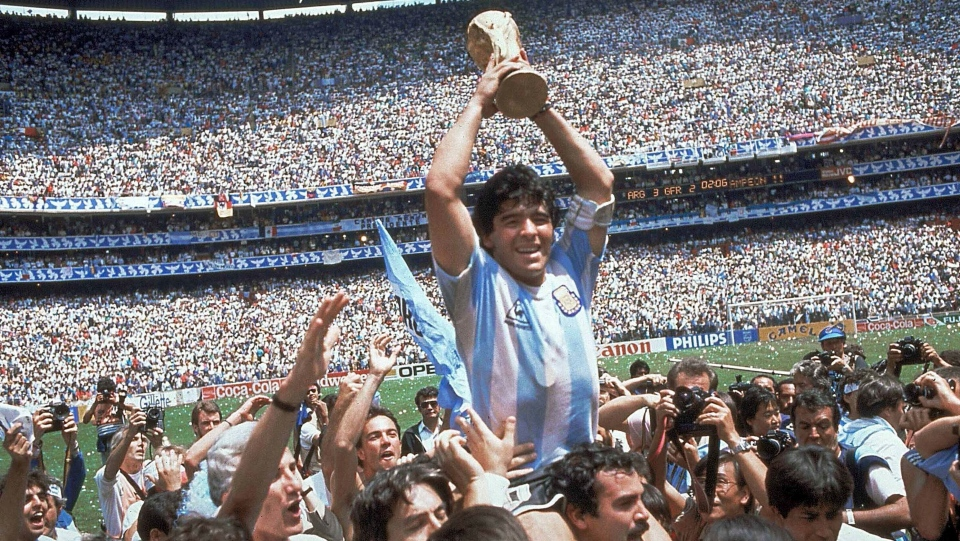 In this June 29, 1986 file photo, Diego Maradona holds up his team's trophy after Argentina's 3-2 victory over West Germany at the World Cup final soccer match at Atzeca Stadium in Mexico City. The Argentine soccer great who was among the best players ever and who led his country to the 1986 World Cup title before later struggling with cocaine use and obesity, died from a heart attack on Wednesday, Nov. 25, 2020, at his home in Buenos Aires. He was 60. (AP Photo/Carlo Fumagalli, File)