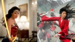 "This combination photo shows Gal Gadot in a scene from the Warner Bros. Pictures film ""Wonder Woman 1984,"" left, and Yifei Liu in a scene from Disney's ""Mulan."" (Warner Bros. via AP, left, and Disney via AP)"