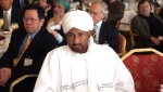 FILE - In this April 11, 2005 file photo, former Sudanese Prime Minister and head of the National Umma Party, Sadiq Al-Mahdi attends a US-Islamic World Forum meeting held in Doha, Qatar. Al-Mahdi, 84, died of COVID-19 late on Wednesday, Nov. 25, 2020, at a hospital in the United Arab Emirates, his party said. (AP Photo, File)