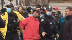 Owner of Adamson BBQ Adam Skelly was taken away in handcuffs by Toronto Police Thursday afternoon after being charged for defying COVID-19 lockdown rules.