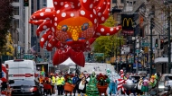 Participants dancing in the modified Macy's Thanksgiving Day Parade are seen from a barricade about two blocks away in New York, Thursday, Nov. 26, 2020. Due to the pandemic, crowds of onlookers were not allowed to attend the annual parade. (AP Photo/Craig Ruttle)