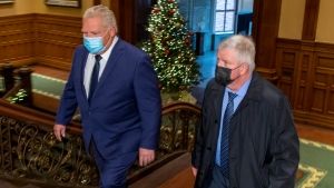 Ontario Premier Doug Ford and former head of the Canadian Armed Forces Gen. Rick Hillier walk to the PremerÕs office at the Ontario Legislature in Toronto on Friday November 27, 2020. Hillier is to lead a new task force that will oversee the rollout of the COVID-19 vaccine in the province. THE CANADIAN PRESS/Frank Gunn