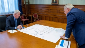 Ontario Premier Doug Ford and former head of the Canadian Armed Forces Gen. Rick Hillier look over a map in the PremerÕs office at the Ontario Legislature in Toronto on Friday November 27, 2020. Hillier is to lead a new task force that will oversee the rollout of the COVID-19 vaccine in the province. THE CANADIAN PRESS/Frank Gunn