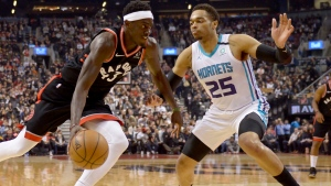 Toronto Raptors forward Pascal Siakam (43) looks to drive to the net around Charlotte Hornets forward PJ Washington (25) during first half NBA basketball action in Toronto, Friday, Feb. 28, 2020. THE CANADIAN PRESS/Nathan Denette
