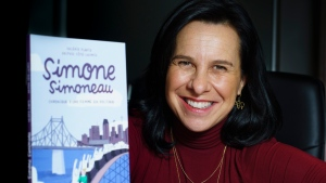 "Montreal Mayor Valerie Plante is pictured with her new book Simone Simoneau in Montreal on Friday, November 20, 2020. Plante can now add ""author"" to her resume with the publication of a graphic novel in which she recounts her entry into politics and takes subtle digs at the sexism she's encountered along the way. THE CANADIAN PRESS/Paul Chiasson"