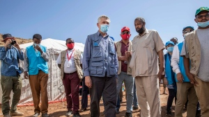 Filippo Grandi, U.N. High Commissioner for Refugees, visits Umm Rakouba refugee camp sheltering people who fled the conflict in Ethiopia's Tigray region in Qadarif, eastern Sudan, Saturday, Nov. 28, 2020. (AP Photo/Nariman El-Mofty)