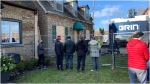 Protesters are seen gathered outside of a property in Mimico that could be demolished before it is approved for heritage status. (Cindy Bleeks)
