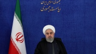 In this photo released by the official website of the office of the Iranian Presidency, Iranian President Hassan Rouhani attends a meeting of his government's coronavirus taskforce in Tehran, Iran, Saturday, Nov. 28, 2020. Rouhani vowed Saturday to exact revenge over the killing of Mohsen Fakhrizadeh, a scientist linked to Tehran's disbanded military nuclear program as he joined other officials in blaming Israel for the slaying. (Iranian Presidency Office via AP)