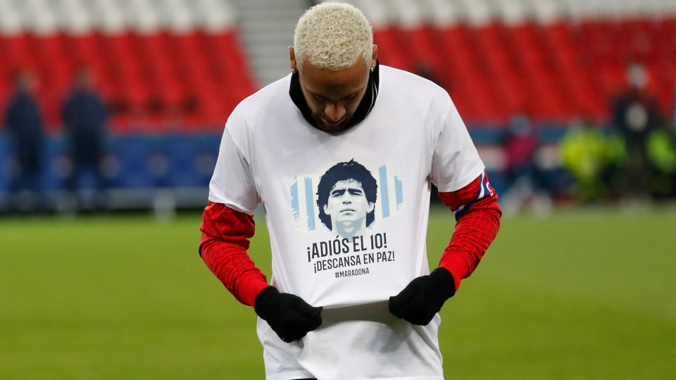 PSG's Neymar wears a shirt with the face of Diego Maradona during a training session prior to the start of the French League One soccer match between Paris Saint Germain and Bordeaux, at the Parc des Princes stadium in Paris, France, Saturday, Nov. 28, 2020. (AP Photo/Thibault Camus)