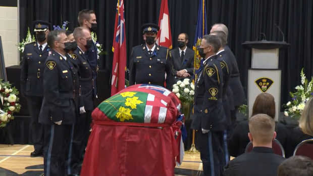 Const. Marc Hovingh's pallbearers stand at casket at the end of the funeral. Nov. 28/20 (CTV Northern Ontario)