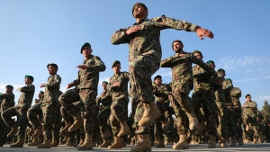 Newly graduated Afghan National Army march during their graduation ceremony after a three month training program at the Afghan Military Academy in Kabul, Afghanistan, Sunday, Nov. 29, 2020. (AP Photo/Rahmat Gul)