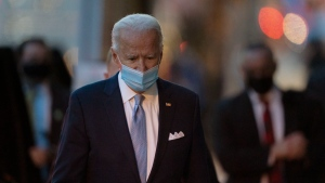 President-elect Joe Biden walks to speak to the media as he leaves The Queen theater, Tuesday, Nov. 24, 2020, in Wilmington, Del. (AP Photo/Carolyn Kaster)