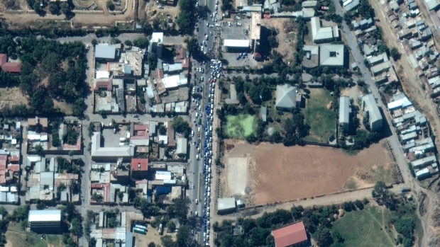 This satellite image taken Monday, Nov. 23, 2020 and released by Maxar Technologies, shows vehicles queuing for fuel in Mekele, the capital of the Tigray region of Ethiopia. (Maxar Technologies via AP)