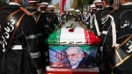 "In this photo released by the official website of the Iranian Defense Ministry, military personnel stand near the flag-draped coffin of Mohsen Fakhrizadeh, a scientist who was killed on Friday, during a funeral ceremony in Tehran, Iran, Monday, Nov. 30, 2020. Fakhrizadeh founded Iran's military nuclear program two decades ago, and the Islamic Republic's defense minister vowed to continue the man's work ""with more speed and more power."" (Iranian Defense Ministry via AP)"