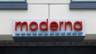 FILE - In this Monday, May 18, 2020, file photo, a sign marks an entrance to a Moderna, Inc., building, in Cambridge, Mass. Moderna Inc. says it will ask U.S. and European regulators to allow emergency use of its COVID-19 vaccine as new study results confirm the shots offer strong protection. (AP Photo/Bill Sikes, File)