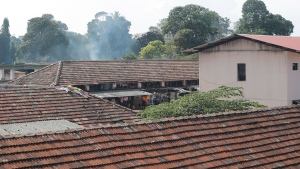 Smoke rises from a ward at the Mahara prison complex following overnight unrest in Mahara, outskirts of Colombo, Sri Lanka, Monday, Nov. 30, 2020. Sri Lankan officials say six inmates were killed and 35 others were injured when guards opened fire to control a riot at a prison on the outskirts of the capital. Two guards were critically injured. Pandemic-related unrest has been growing in Sri Lanka's overcrowded prisons. (AP Photo/Eranga Jayawardena)
