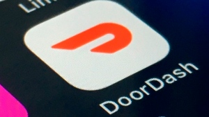 The DoorDash app is shown on a smartphone on Feb. 27, 2020, in New York. (AP Photo)