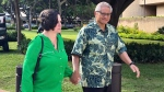 In this March 12, 2019, file photo, retired Honolulu police chief Louis Kealoha and his wife, former deputy city prosecutor Katherine Kealoha, hold hands while walking to U.S. district court in Honolulu.  (AP Photo/Jennifer Sinco Kelleher, File)