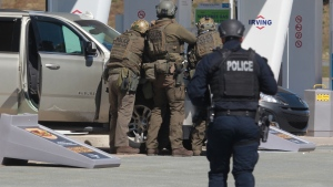 RCMP officers prepare to take a person into custody at a gas station in Enfield, N.S. on Sunday April 19, 2020. The Nova Scotia RCMP provided a partial timeline of what happened last weekend when a man posing as an RCMP officer killed 22 people before he was fatally shot by police on Sunday, a little over 12 hours after he started what would become one of the worst mass killings in Canadian history. THE CANADIAN PRESS/Tim Krochak