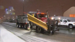 A snow plow drives through a street in Toronto on Dec. 1, 2020. (CP24)
