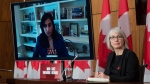 Public Services and Procurement Minister Anita Anand responds to a question via video conference as Minister of Health Patty Hajdu looks on during a news conference Tuesday December 1, 2020 in Ottawa. THE CANADIAN PRESS/Adrian Wyld