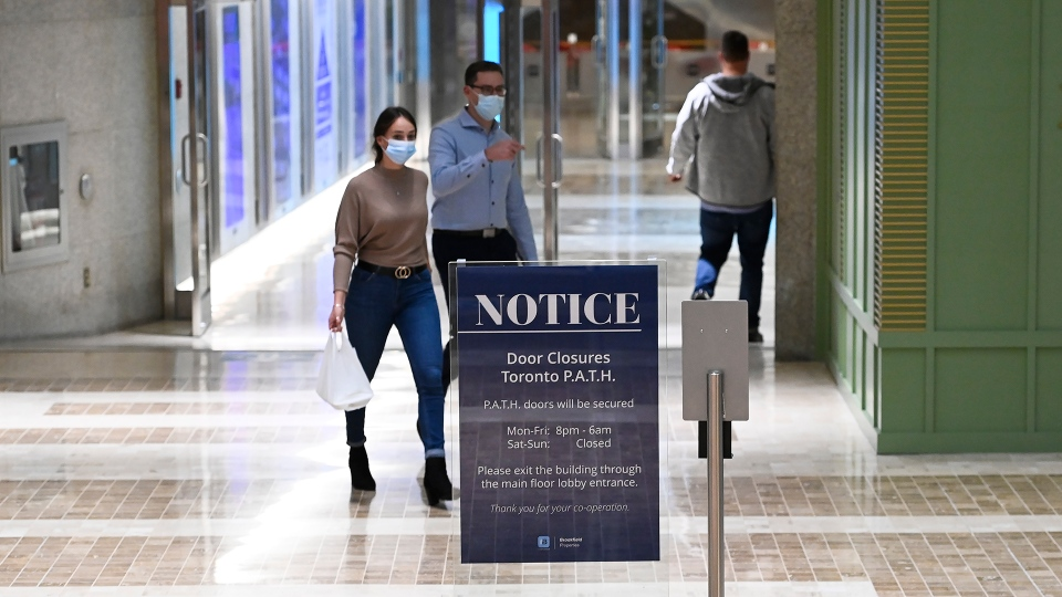 People walk around the underground PATH at the lunch hour where retailers are open during the COVID-19 pandemic in Toronto on Tuesday, October 13, 2020. THE CANADIAN PRESS/Nathan Denette