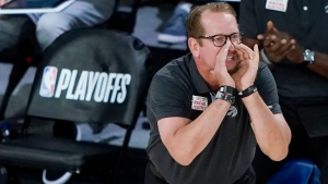 FILE - Toronto Raptors' head coach Nick Nurse yells to his players during the first half of an NBA basketball conference semifinal playoff game against the Boston Celtics in Lake Buena Vista, Fla., in this Sunday, Aug. 30, 2020, file photo. (AP Photo/Ashley Landis, File)