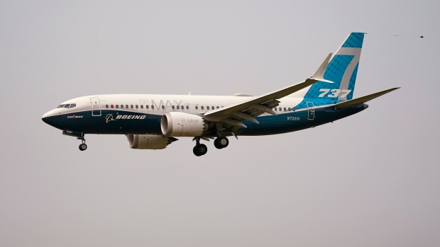 FILE - In this Sept. 30, 2020 file photo, a Boeing 737 Max jet, piloted by Federal Aviation Administration (FAA) chief Steve Dickson, prepares to land at Boeing Field following a test flight in Seattle. (AP Photo/Elaine Thompson, File)