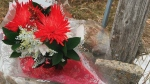 A bouquet of flowers has been laid at the site where two siblings were hit by a vehicle in Port Hope. (CTV News)