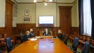 Ontario Premier Doug Ford, centre, sits with retired chief of national defence staff Gen. Rick Hillier, chair of the COVID-19 Vaccine Distribution Task Force, Health Minister Christine Elliott, right, and solicitor general Sylvia Jones during a meeting at the Queens Park Legislature in Toronto on Friday December 4, 2020. THE CANADIAN PRESS/Chris Young