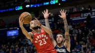 Toronto Raptors guard Fred VanVleet (23) shoots next to New Orleans Pelicans guard Lonzo Ball (2) during the first half of an NBA basketball game in New Orleans, Friday, Nov. 8, 2019. (AP Photo/Matthew Hinton)