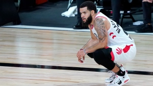 Toronto Raptors' Fred VanVleet looks on during a coach's challenge in the first half of an NBA basketball game against the Boston Celtics Friday, Aug. 7, 2020 in Lake Buena Vista, Fla. (AP Photo/Ashley Landis, Pool)