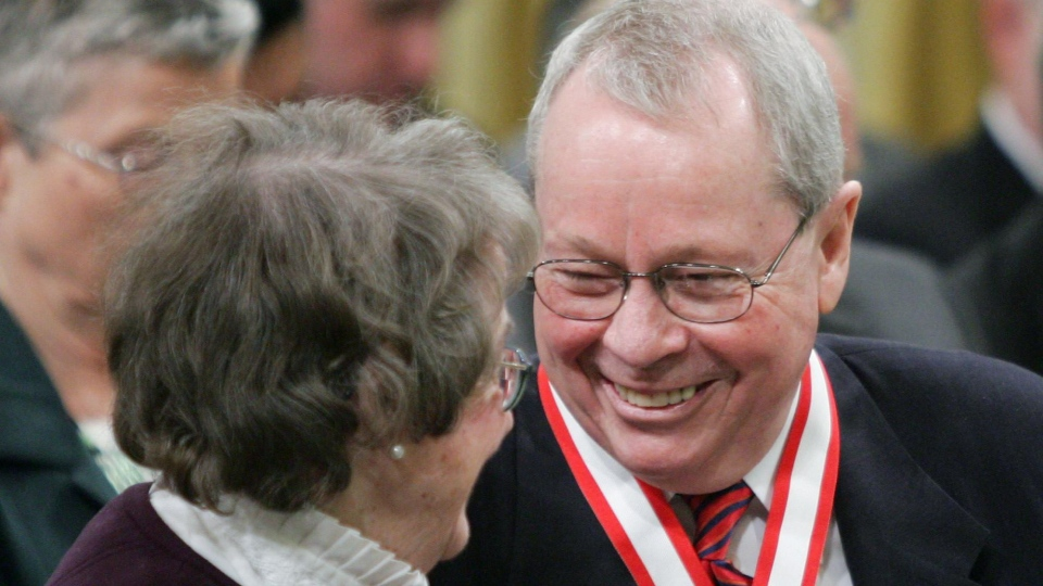 Former Toronto Mayor David Crombie of Toronto, (right) laughs with Budge Wilson of Halifax, N.S. after receiving the Order of Canada during a ceremony at Rideau Hall in Ottawa Friday, March 11, 2005. (CP PHOTO/Jonathan Hayward)