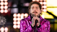 This Tuesday, Dec. 31, 2019, file photo shows Post Malone performing at the Times Square New Year's Eve celebration in New York. (Photo by Ben Hider/Invision/AP, File)