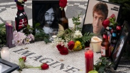 Items are left at Strawberry Fields to remember John Lennon, Tuesday, Dec. 8, 2020 in New York. The rock star and former Beatle was shot to death outside his New York City apartment building by a fan on Dec. 8, 1980. (AP Photo/Mark Lennihan)