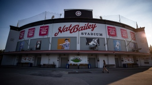 People walk past Nat Bailey Stadium during a fan batting practice session hosted by the Vancouver Canadians minor league baseball team, in Vancouver, on Thursday, September 3, 2020.  THE CANADIAN PRESS/Darryl Dyck
