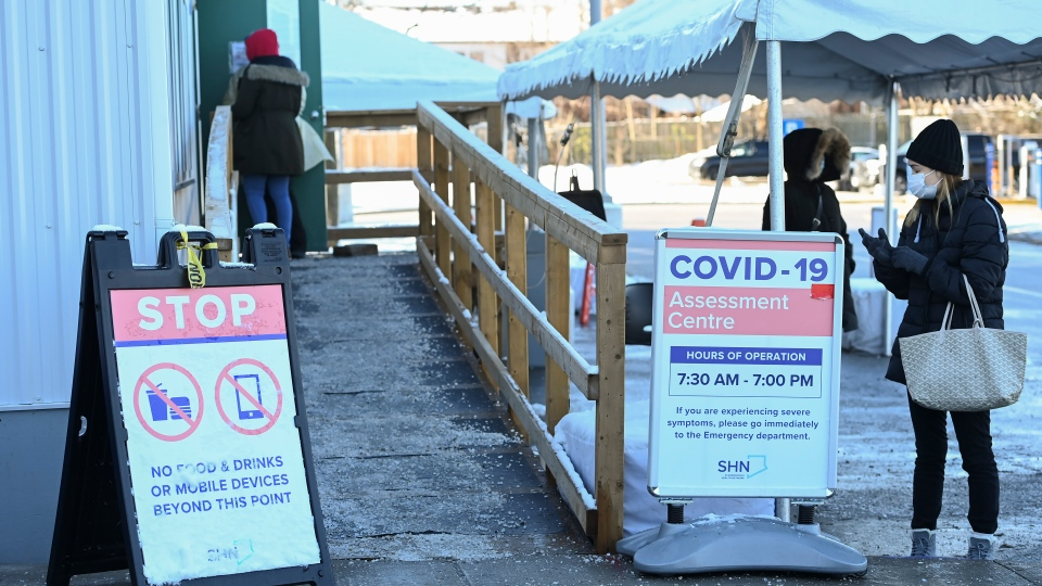 People line up at a COVID-19 assessment centre during the COVID-19 pandemic in Scarborough, Ont., on Wednesday, December 2, 2020. Toronto and Peel region continue to be in lockdown. THE CANADIAN PRESS/Nathan Denette
