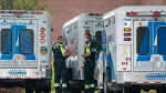 Paramedics stand by their ambulances at Toronto Western Hospital in Toronto on Tuesday October 27, 2020. The hospital has declared a COVID-19 outbreak and has closed some wards. THE CANADIAN PRESS/Frank Gunn