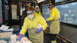 Toronto Paramedics prepare the Mobile COVID-19 TTC testing bus at a stop in Toronto on December 9, 2020. THE CANADIAN PRESS/Frank Gunn