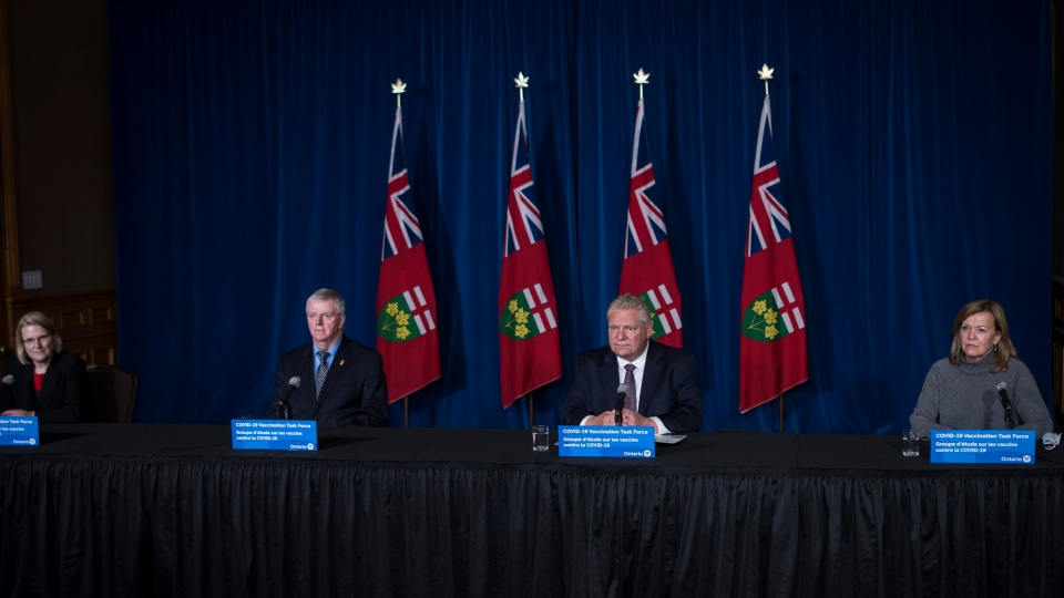 Solicitor General Sylvia Jones, left to right, retired General Rick Hillier, Ontario Premier Doug Ford and Christine Elliott, Deputy Premier and Minister of Health , are photographed press conference regarding COVID-19 vaccine distribution, at Queen's Park in Toronto on Friday, December 11, 2020. THE CANADIAN PRESS/Tijana Martin