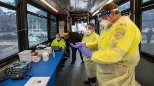 Toronto Paramedics prepare the Mobile COVID-19 TTC testing bus at a stop in Toronto December 9, 2020. THE CANADIAN PRESS/Frank Gunn