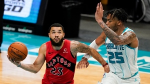 Toronto Raptors guard Fred VanVleet shoots around Charlotte Hornets forward PJ Washington during the first half of an NBA preseason basketball game in Charlotte, N.C., on Saturday, Dec. 12, 2020. (AP Photo/Chris Carlson)