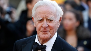 "FILE - This Sept. 13, 2011, file photo shows British author John Le Carre at the UK film premiere of ""Tinker Tailor Soldier Spy,"" in London. John le Carre, the spy-turned-novelist whose elegant and intricate narratives defined the Cold War espionage thriller and brought acclaim to a genre critics had once ignored, has died. He was 89, Le Carre's literary agency, Curtis Brown, said Sunday, Dec. 13, 2020 that he died in Cornwall, southwest England on Saturday. (AP Photo/Sang Tan, File)"