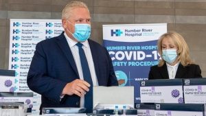 Ontario Premier Doug Ford and Long-Term Care Minister Merrilee Fullerton listen as they are briefed on Covid-19 Rapid Test Device kits at Humber River Hospital in Toronto on Tuesday November 24, 2020.  THE CANADIAN PRESS/Frank Gunn